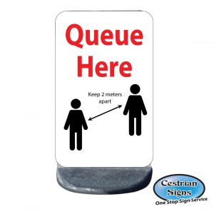 queue here 2 meters apart sign